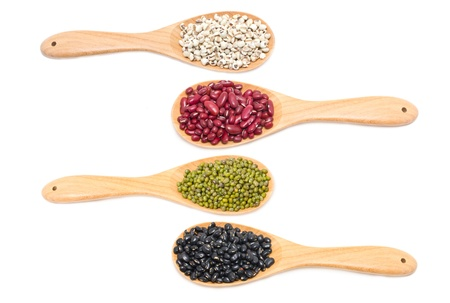 dried herb: Job s tears, Kidney beans, Mung beans and Black beans with wooden spoon isolated on white