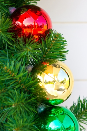 fake christmas tree: Christmas balls decorated on fake pine tree  Stock Photo