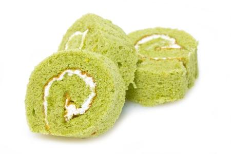 Matcha cake rolls isolated on white