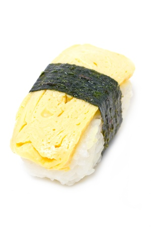 gastronome: Tamago nigiri isolated on white