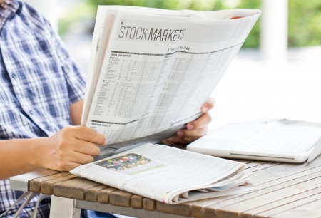 Asian man reading the financial newspaper  photo