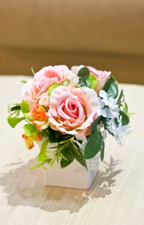 Artificial flowers in vase  photo
