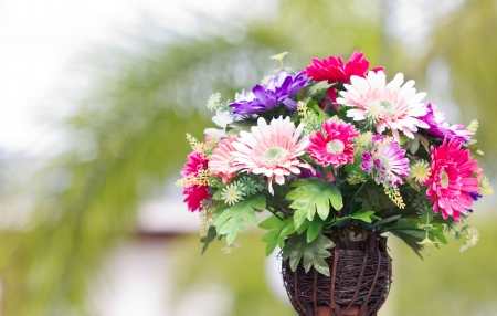 Artificial flowers in wooden vase  photo