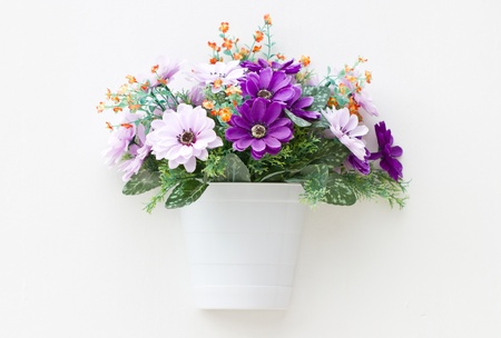 Artificial flowers in the wall  photo