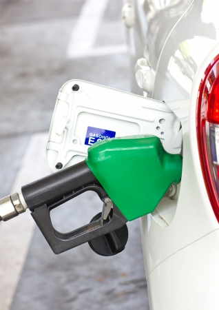 refuel: Car With A Gas Pump  Stock Photo