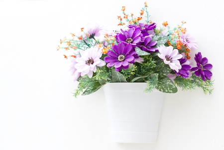 artificial flower: Artificial flowers in the wall  Stock Photo