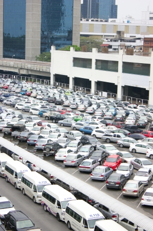 BANGKOK - APRIL 3, 2013: Many people parked their cars at BTSs parking lot before transit into town.