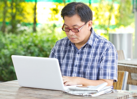 Asian man working with laptop  photo
