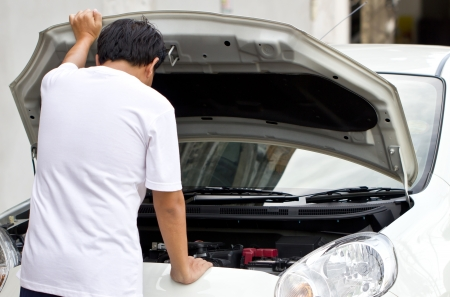 car trouble: Asian man try to repair a broken car  Stock Photo