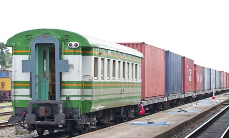 freight train: Cargo train on track at station, Thailand