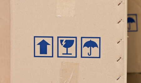 Safety, fragile icons on a cardboard parcel  photo
