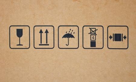 Fine image close-up of fragile symbol on cardboard  photo