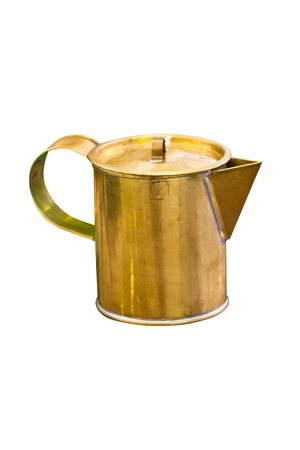 Brass pitcher isolated on white background  photo