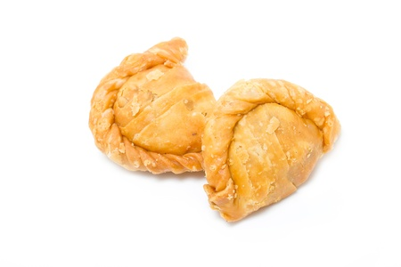Two curry puffs isolated on white