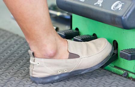 nitrogen: Foot On Nitrogen Tire Filling System Machine. Stock Photo