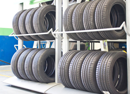 Rows Of New Tires On Rack Stock Photo