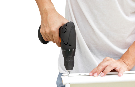 electric drill: Furniture Assembling Using Battery Drill. Stock Photo
