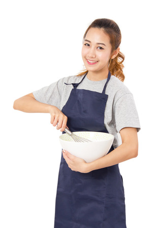 asian chef: Young Woman With Whisk And Bowl Isolated On White. Stock Photo