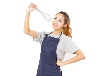 chef kitchen: Asian Woman Wearing Apron And Singing With Whisk Isolated On White.