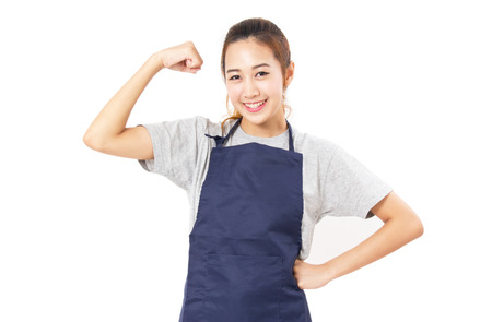 arms akimbo: Asian Woman Wearing Apron And Flex Her Muscles Isolated On White. Stock Photo