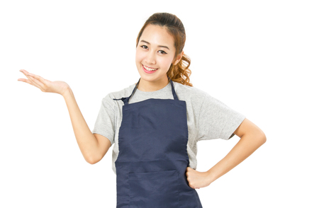 retail store: Asian Woman Wearing Apron And Singing With Open Palm Hand Isolated On White.
