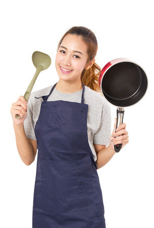 pan asian: Asian Woman Wearing Apron And Showing Pan With Utensil Stock Photo