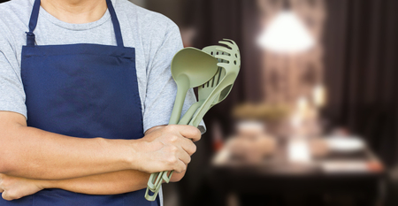chef kitchen: Asian Man Cross Arm With Cooking Tools Stock Photo