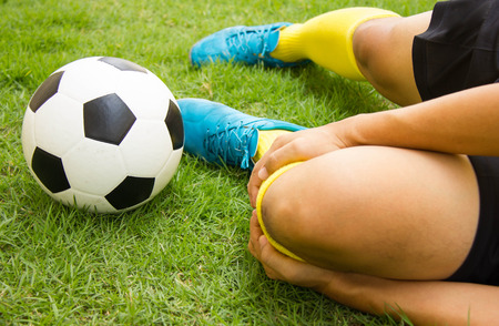 Close-up Of Injured Football Player On Field. Stock Photo