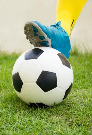 kickoff: Football or soccer ball at the kickoff of a game.