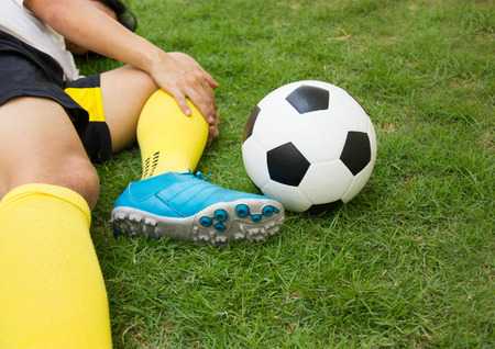leg injury: Close-up Of Injured Football Player On Field. Stock Photo