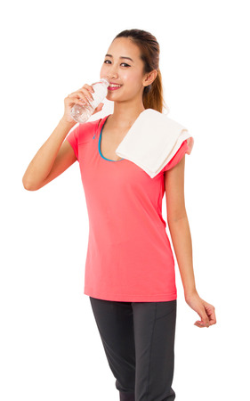 water sports: Happy smiling asian woman in fitness wear with bottle of water on white background.