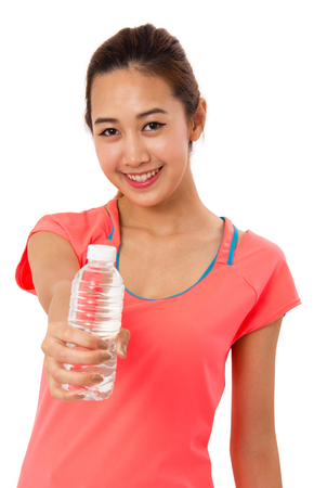 water sport: Happy smiling asian woman in fitness wear with bottle of water on white background.