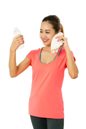 drink water: Happy smiling asian woman in fitness wear with bottle of water on white background.