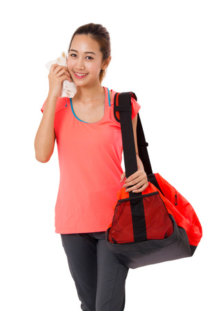 woman bag: Asian Smiling fit young woman with gym bag standing ready for fitness exercise Isolated on white background.