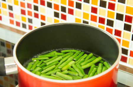 Lentils Pieces In Boiling Water In Red Pot.