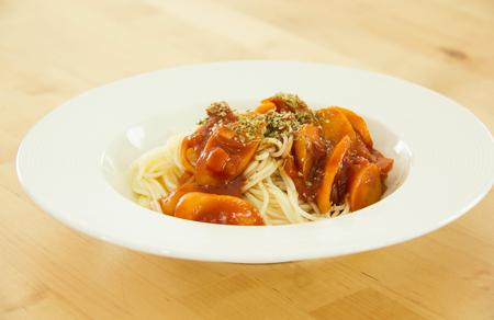 oregano: Sprinkling Oregano On Spaghetti.