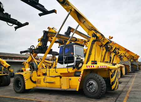 handlers: Parking Space Area With Yellow Strip Line For Heavy Transportation Equipment Container Handlers