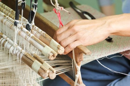 Close Up Of Asian Man Hand Weaving