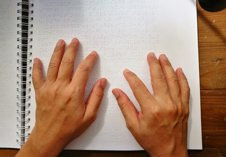Top View Finger Touch To Braille Code, Blind Man Read Book Written In Braille.