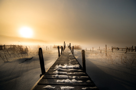 Wooden bridge in the winter Фото со стока