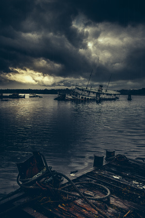 The harsh mood and feel around the old sunken ship in the harbour in the north of Sweden