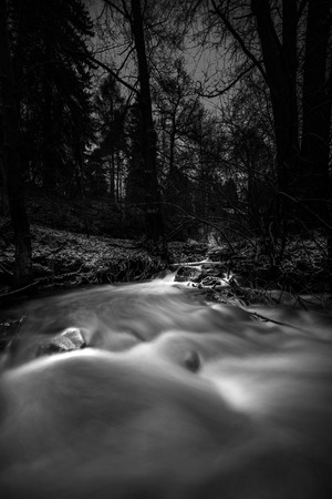 Running waters in the deep forest in the cold winter of Sweden Stock Photo