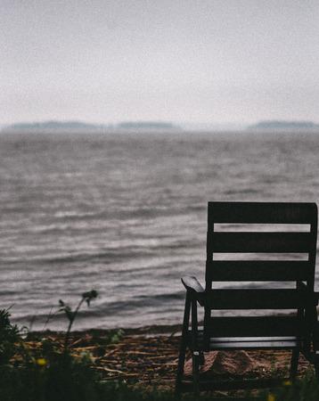 Single chair down by the beach in autumn Фото со стока - 29162480