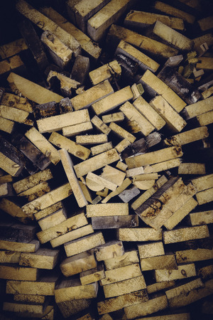 Large amount of wood stacked before the cold winter to be used as fire wood photo