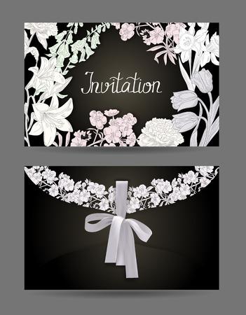 花とリボンの手で黒と白封筒が描かれて