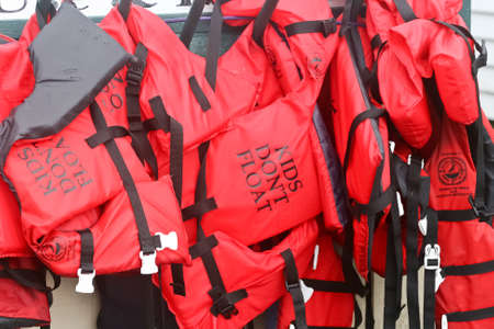 flotation: Red youth and child size life jackets Stock Photo