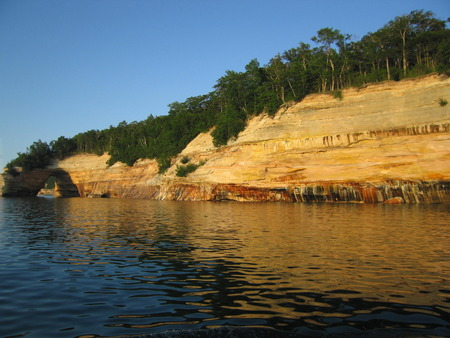 pictured: Cliffs and natural arch of Pictured Rocks Northern Michigan Stock Photo