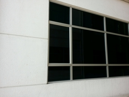 Tinted window on a white wall Stock Photo
