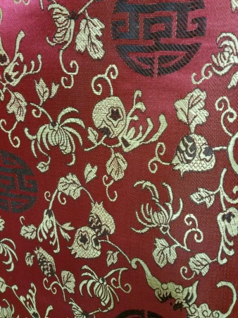 embroidered: Embroidered red Chinese silk