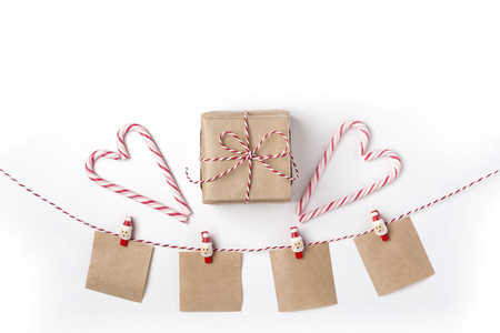 Gift, candles, lollipops, notes with wish on clothespins, Top view White Background Christmas New Year